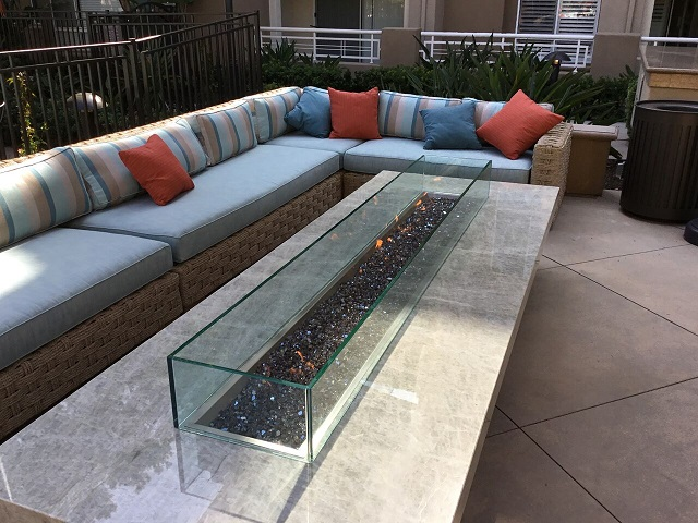 Custom Montecito fire pit table with Quartzite top.