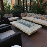 Custom automated Montecito fire pit table with Cafe Creme granite top.