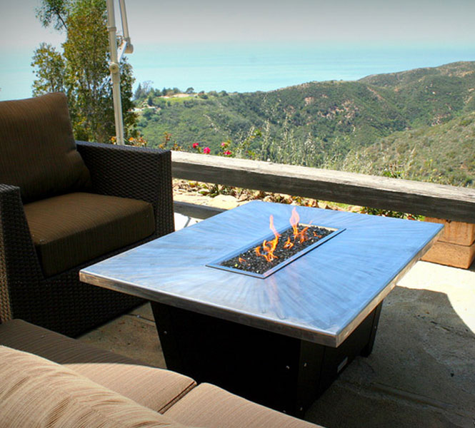 Palisades fire pit table with hand brushed 48'x36' aluminum top.
