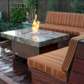Balboa fire pit table, granite and copper plated base.
