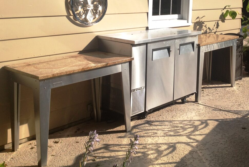 Custom Laguna outdoor kitchen table with Cafe Creme granite top